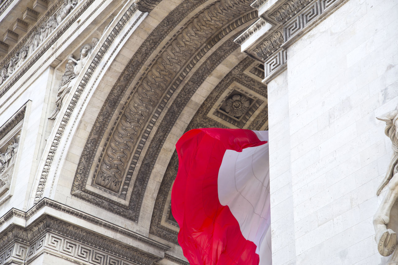 architecture, built structure, low angle view, building exterior, the past, no people, history, travel destinations, red, flag, arch, patriotism, day, tourism, architectural column, building, craft, art and craft, city, neo-classical