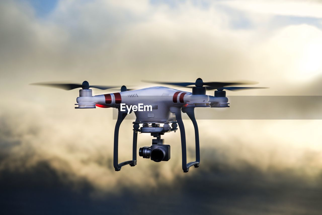 drone, technology, media equipment, camera - photographic equipment, flying, futuristic, no people, outdoors, day, sky, big brother - orwellian concept
