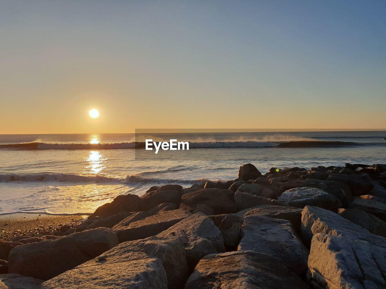 sea, sky, water, rock, beauty in nature, beach, scenics - nature, sunset, rock - object, solid, horizon over water, land, horizon, tranquility, tranquil scene, nature, idyllic, no people, sun, outdoors