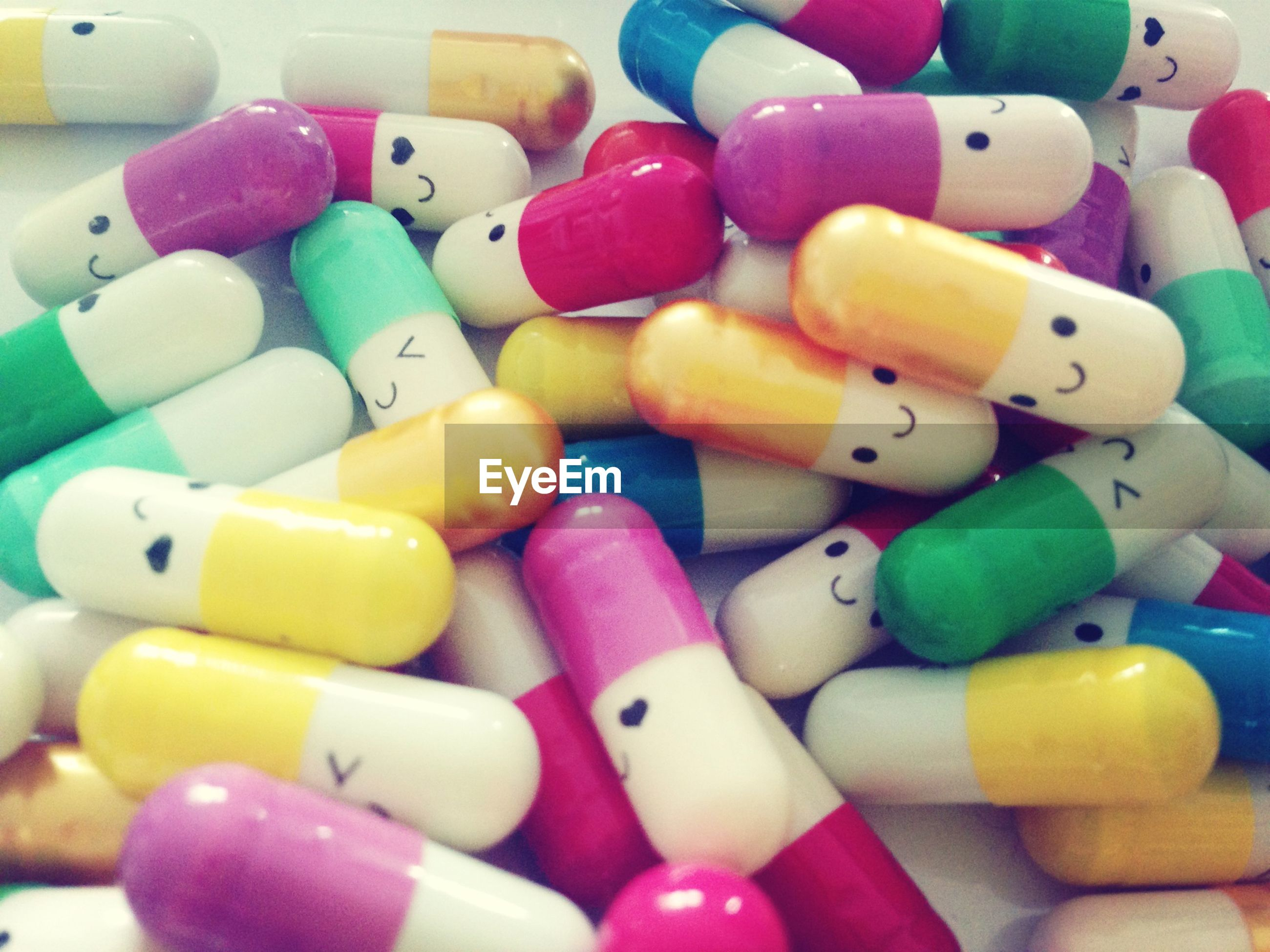 Close-up of multi colored pills with smiley face