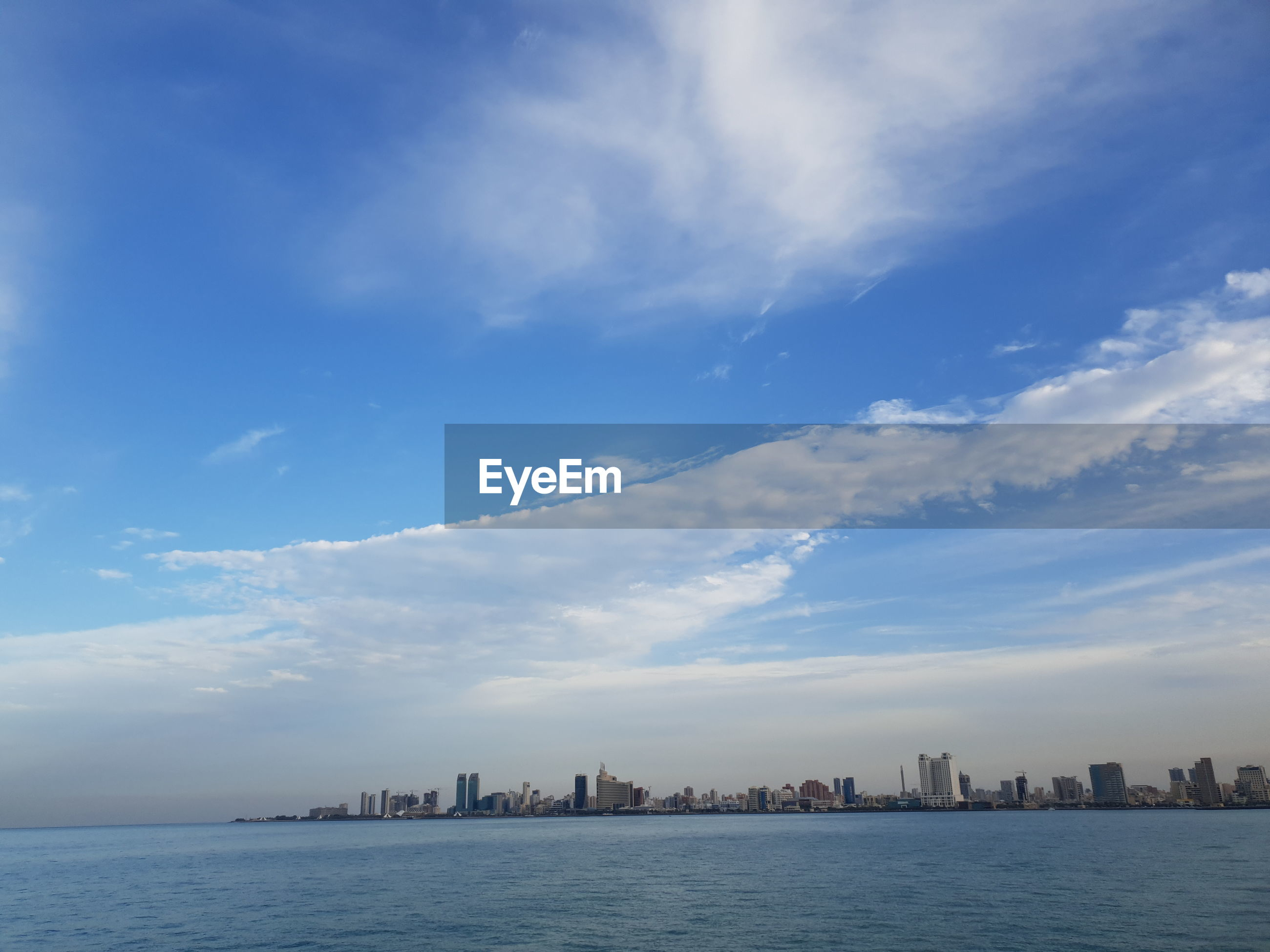 PANORAMIC VIEW OF SEA AGAINST BUILDINGS IN CITY