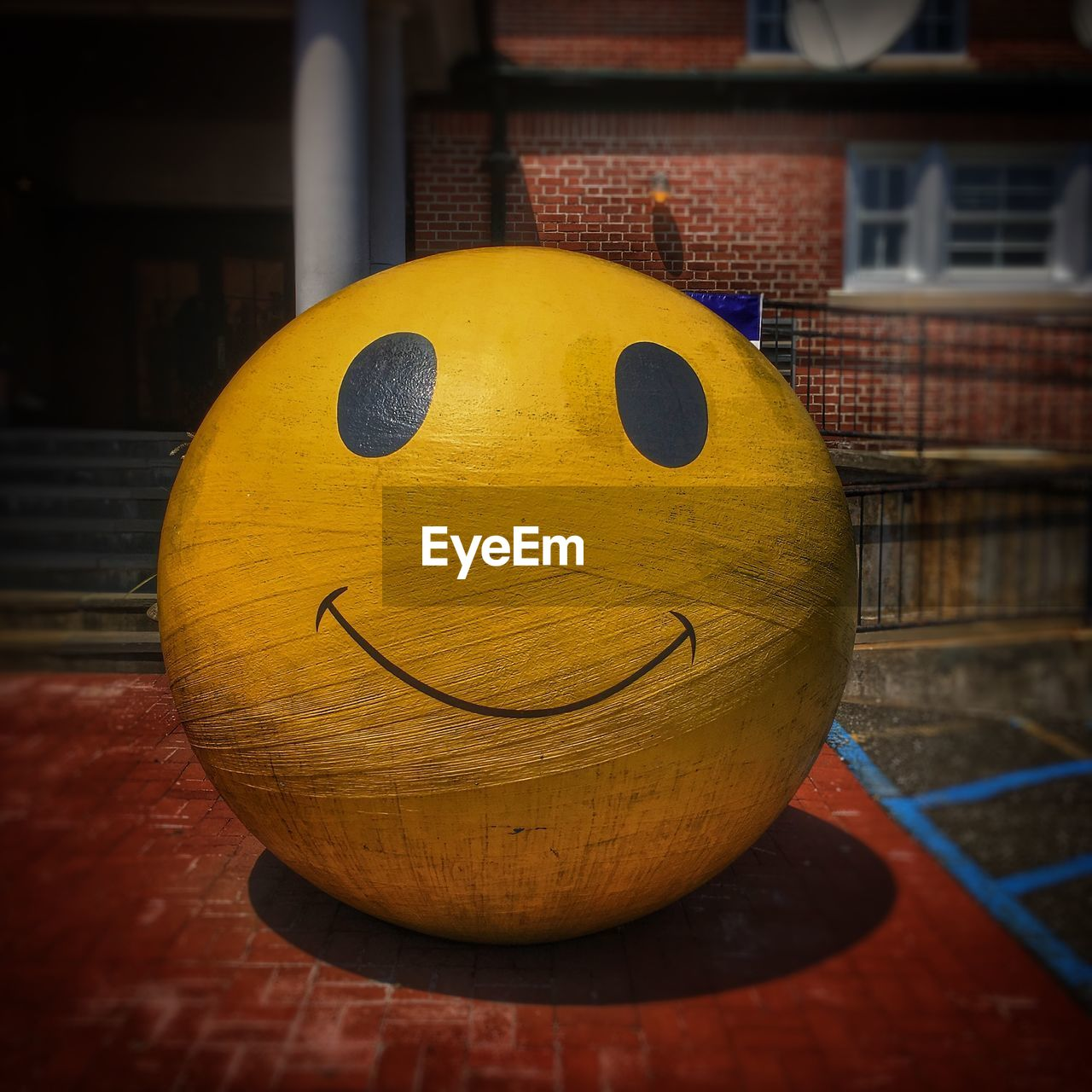 yellow, architecture, close-up, built structure, no people, building exterior, focus on foreground, representation, art and craft, still life, anthropomorphic smiley face, creativity, anthropomorphic face, face, anthropomorphic, ball, sphere, table, smiling