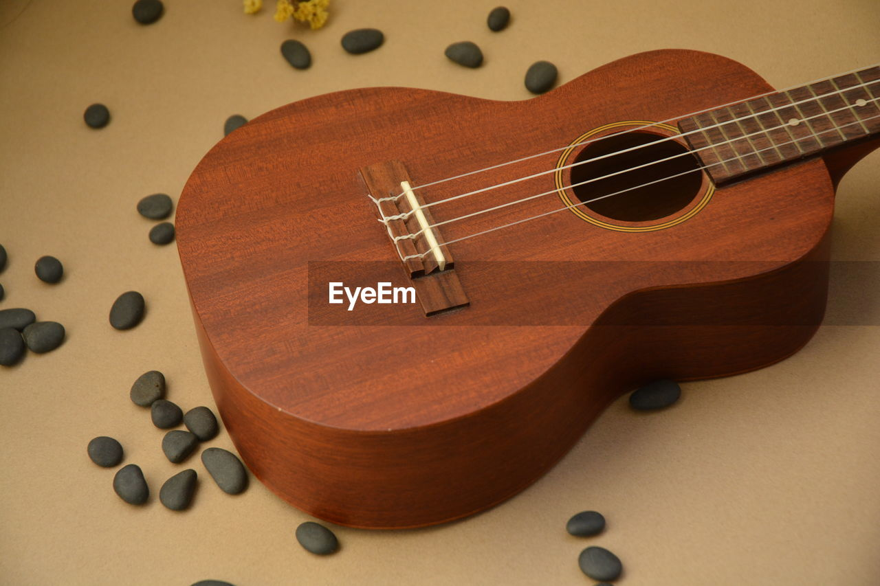 music, musical instrument, musical instrument string, wood - material, brown, arts culture and entertainment, no people, indoors, close-up, guitar, day