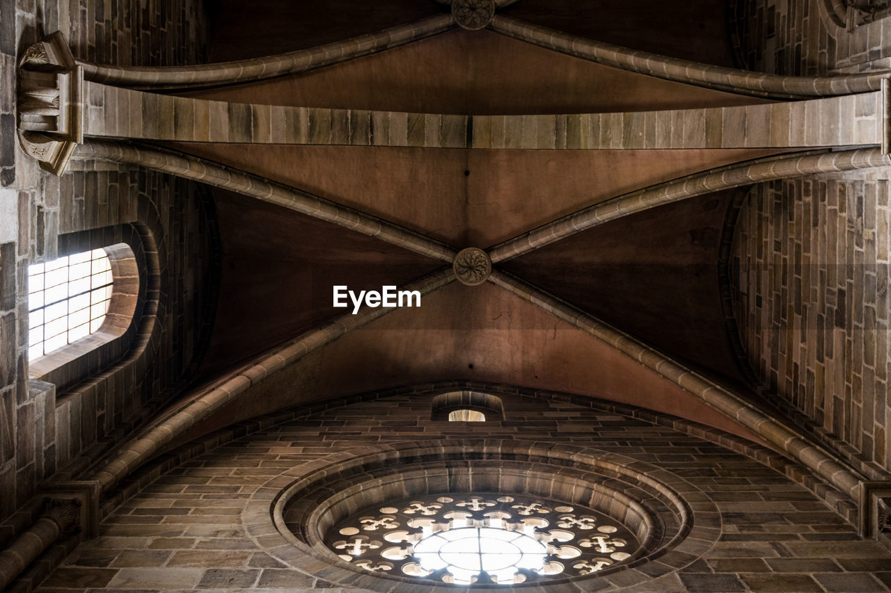 architecture, low angle view, indoors, ceiling, built structure, no people, day