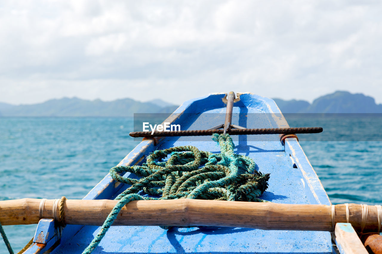 water, rope, nautical vessel, sea, sky, nature, transportation, day, mode of transportation, cloud - sky, metal, no people, tied up, beauty in nature, scenics - nature, outdoors, strength, mountain, close-up, turquoise colored