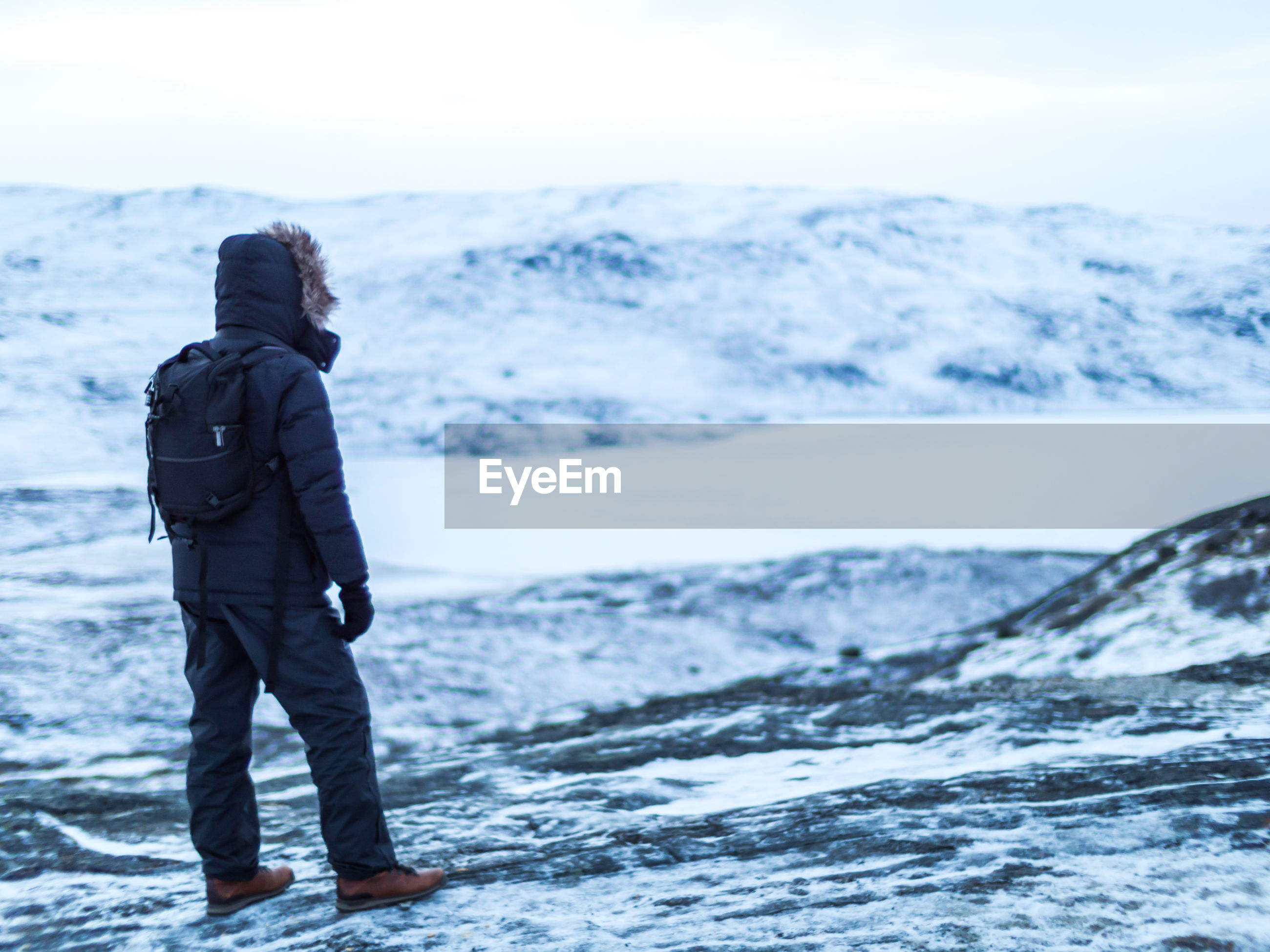Man standing on field during winter