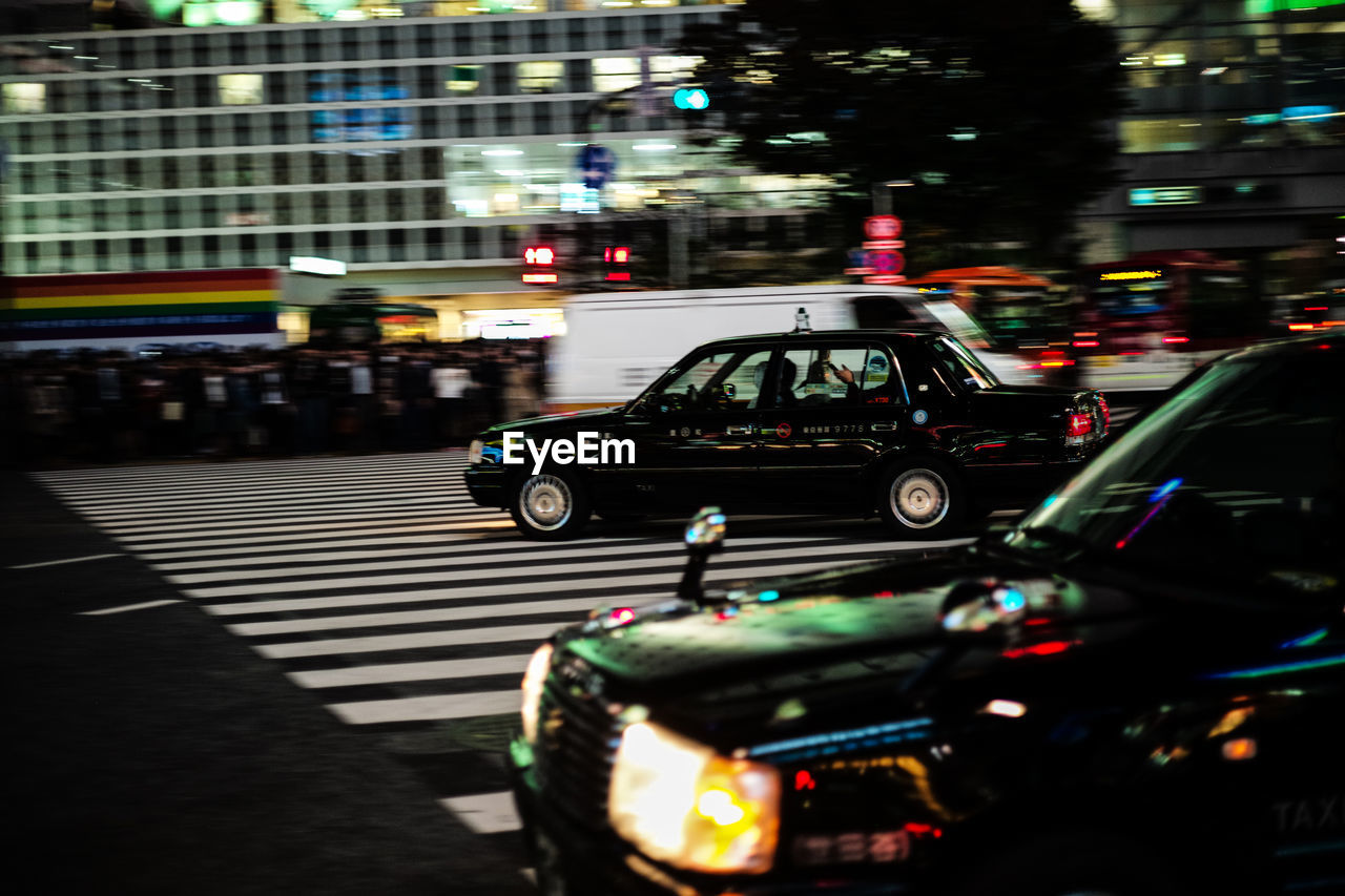 transportation, land vehicle, mode of transport, illuminated, night, street, road, car, outdoors, no people, architecture, city, close-up