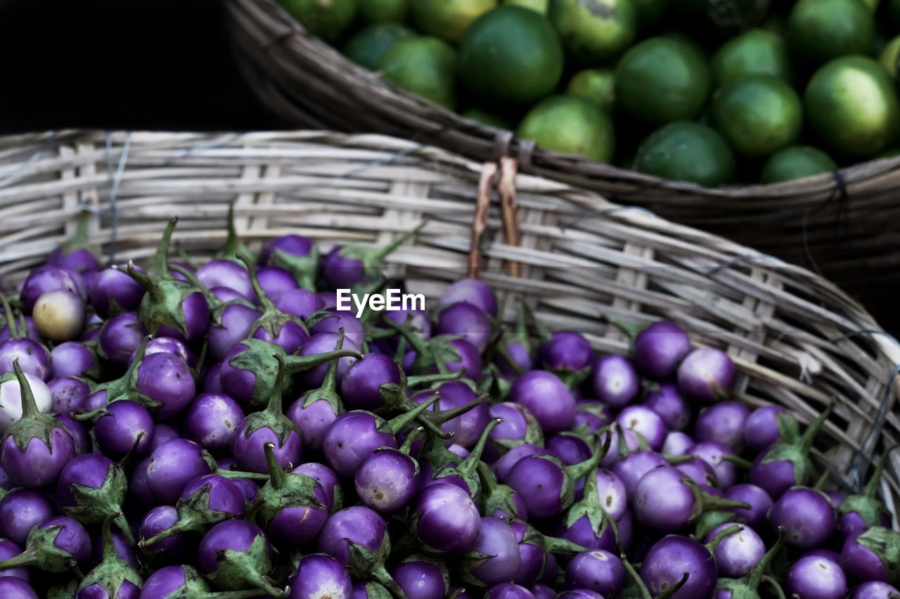 High Angle View Of Eggplants In Basket For Sale