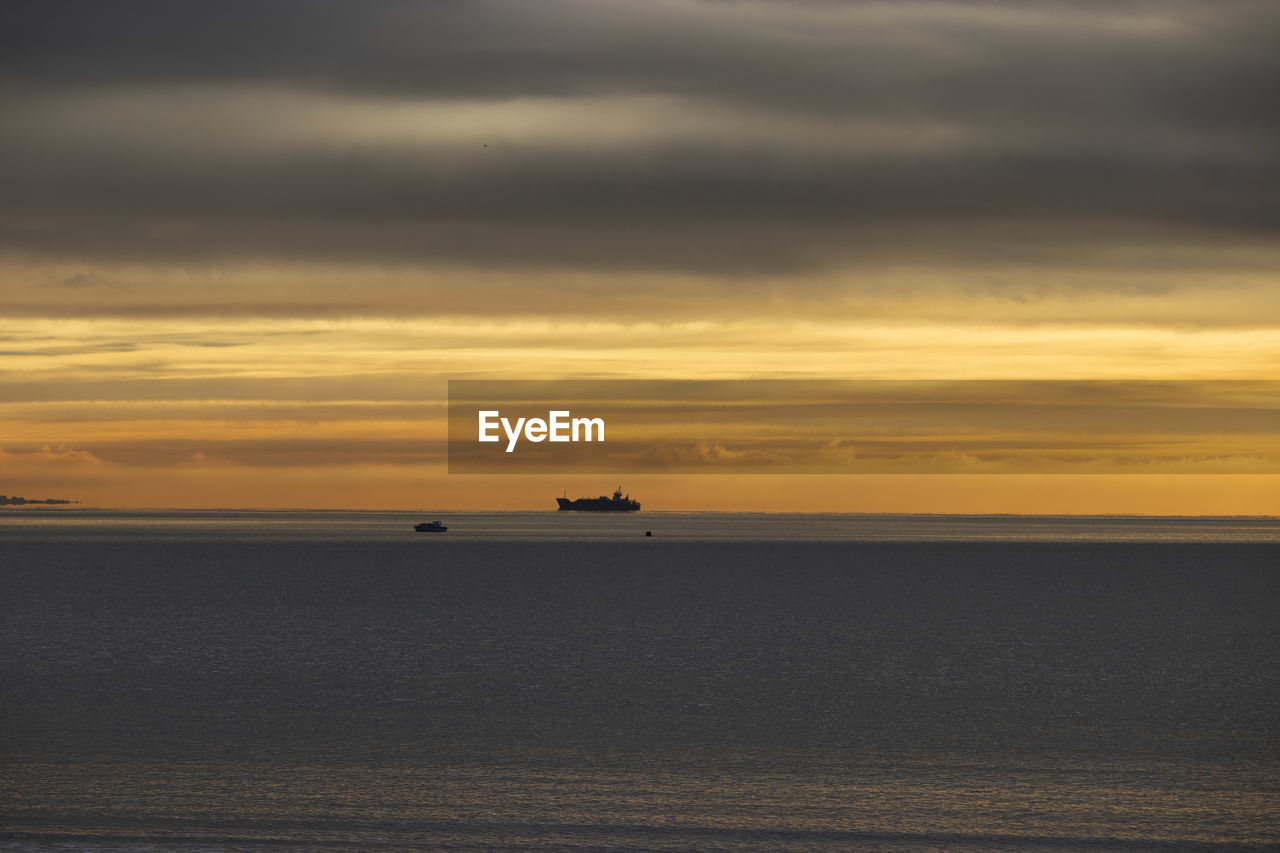 sky, sunset, cloud - sky, water, sea, scenics - nature, horizon, horizon over water, nautical vessel, transportation, beauty in nature, nature, mode of transportation, waterfront, no people, orange color, tranquil scene, ship, tranquility, outdoors