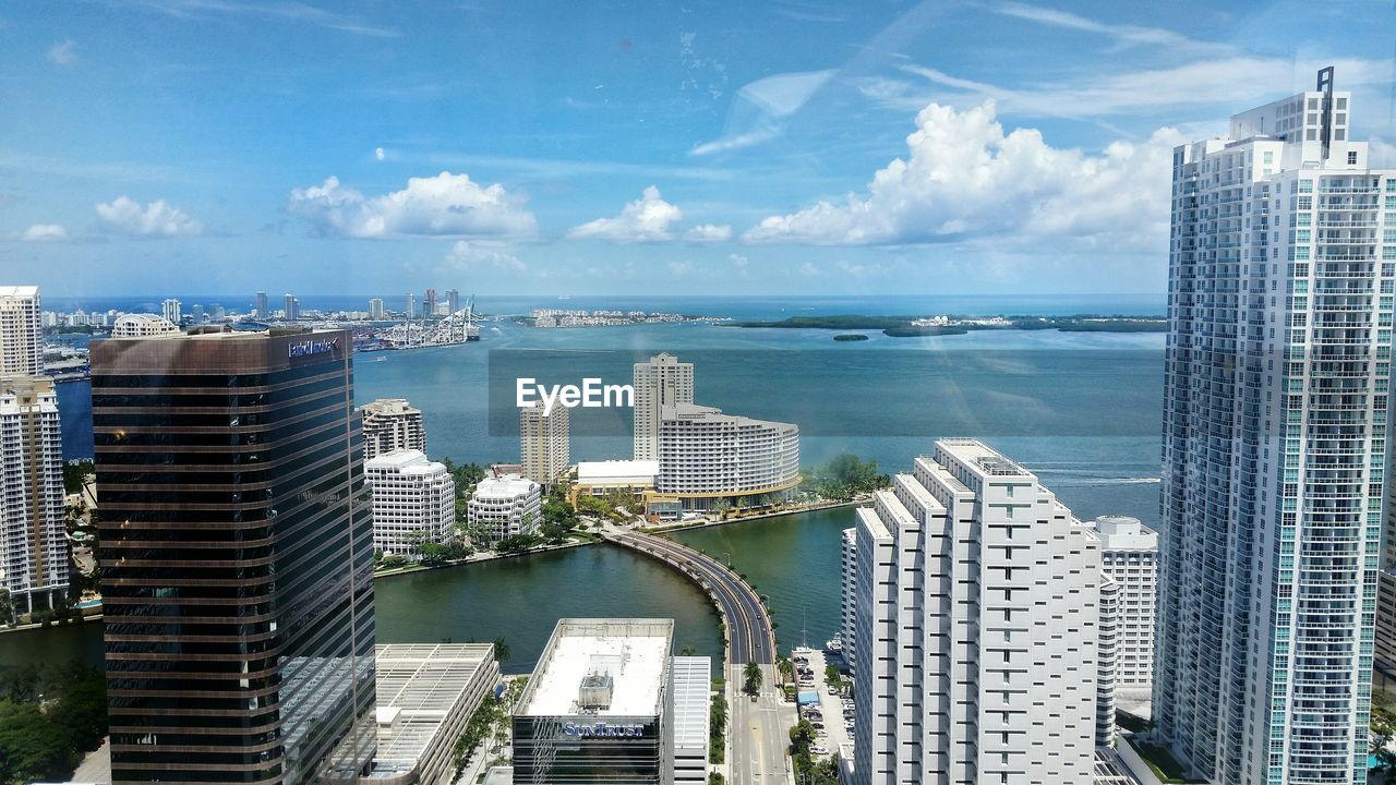 High angle view of modern buildings by biscayne bay against sky