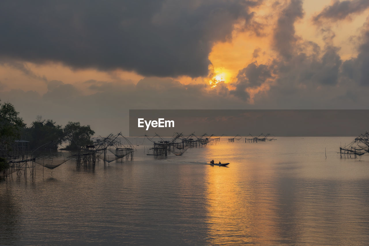 sky, water, cloud - sky, beauty in nature, scenics - nature, sunset, tranquility, tranquil scene, waterfront, transportation, nautical vessel, sea, mode of transportation, nature, idyllic, no people, non-urban scene, tree, outdoors, horizon over water, fishing boat, fishing industry