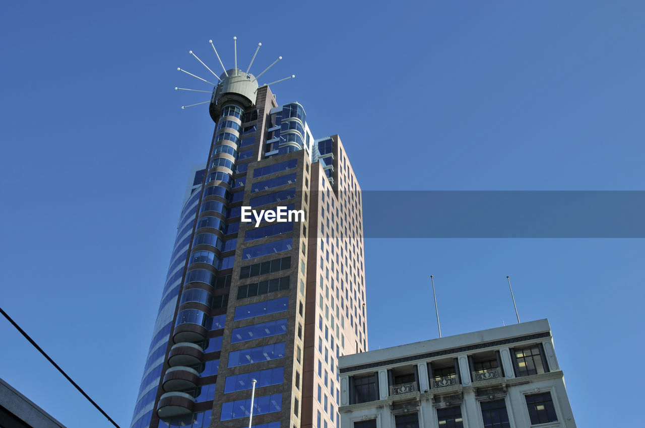 building exterior, built structure, architecture, low angle view, sky, city, building, office building exterior, clear sky, office, modern, skyscraper, tall - high, nature, no people, tower, blue, day, travel destinations, outdoors, luxury