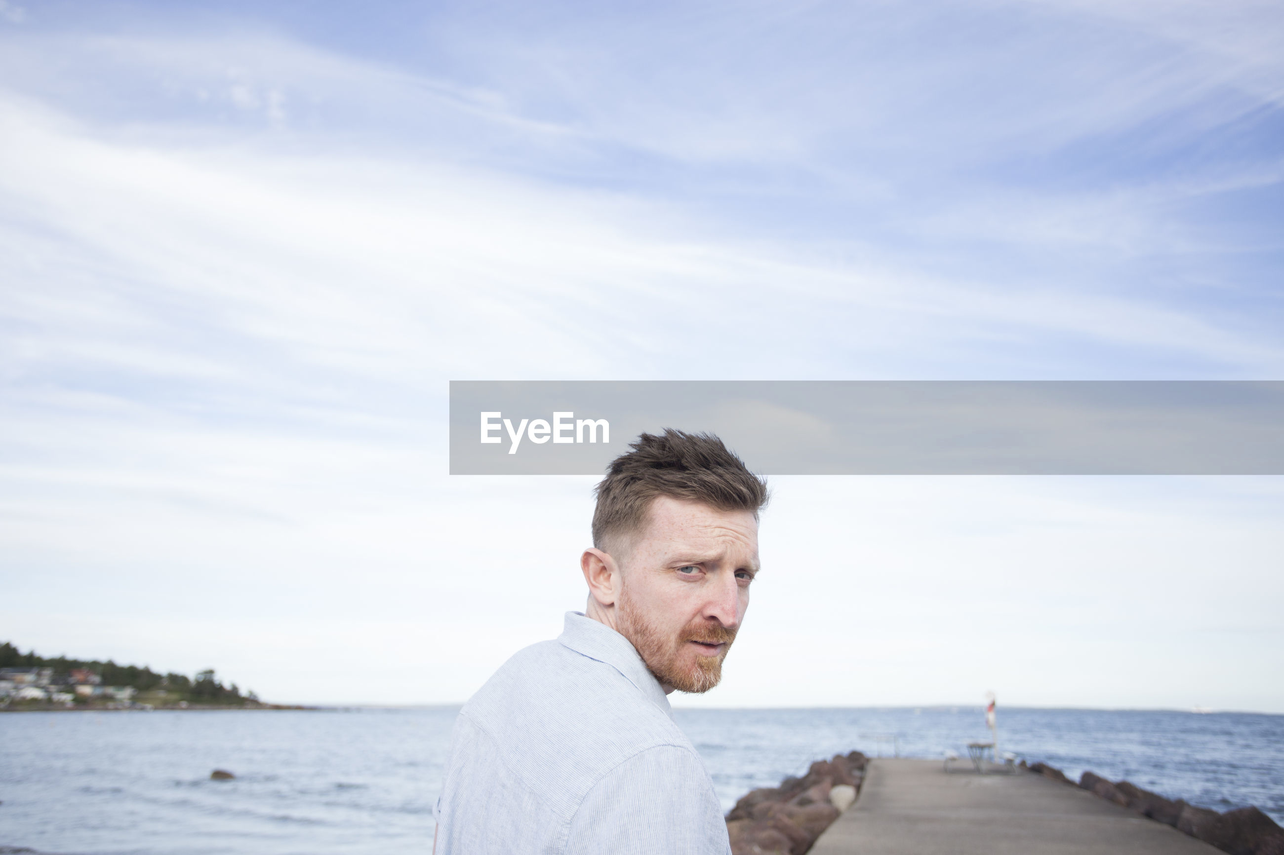 Portrait of man against sea
