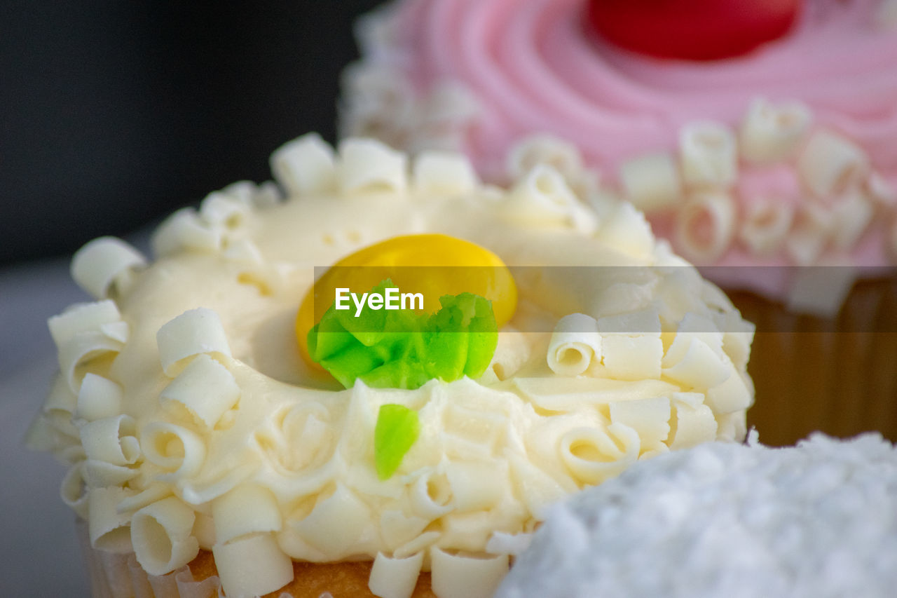sweet, cake, sweet food, food, dessert, freshness, indulgence, temptation, food and drink, unhealthy eating, baked, cupcake, indoors, ready-to-eat, still life, close-up, no people, celebration, icing, wedding cake, whipped cream, cupcake holder, floral pattern, garnish