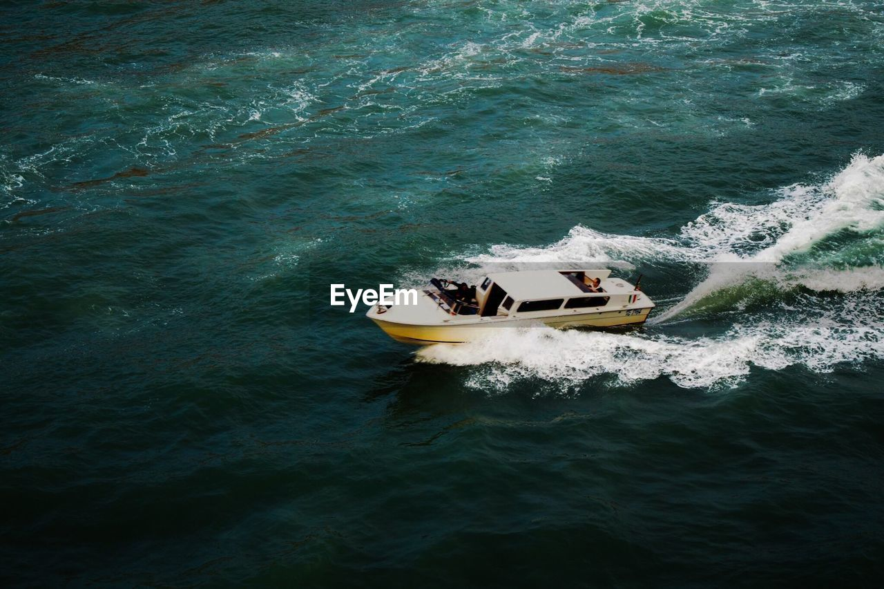 High angle view of motorboat in sea