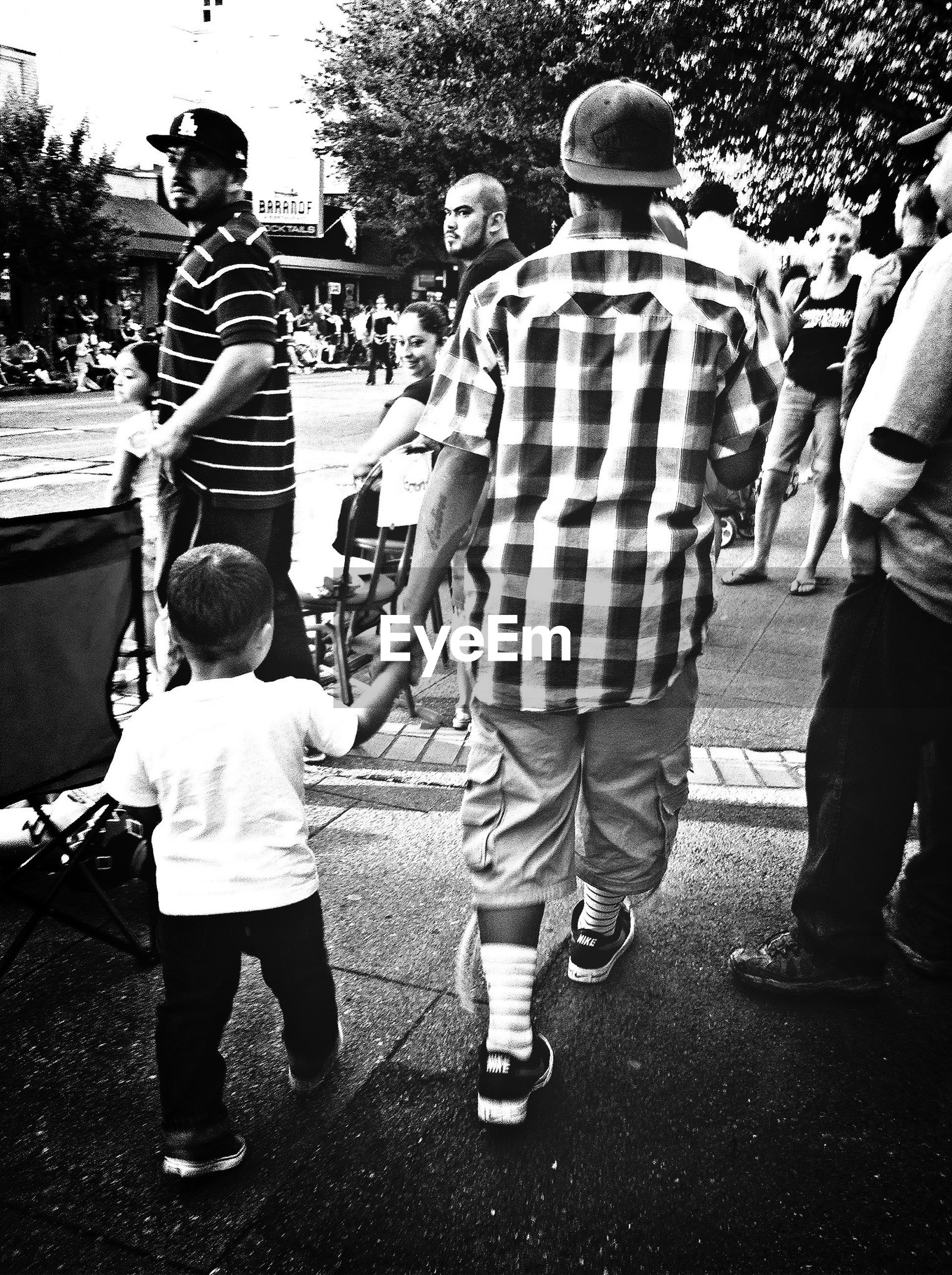 full length, childhood, rear view, lifestyles, casual clothing, togetherness, girls, boys, leisure activity, walking, elementary age, men, standing, bonding, love, park - man made space, person, street
