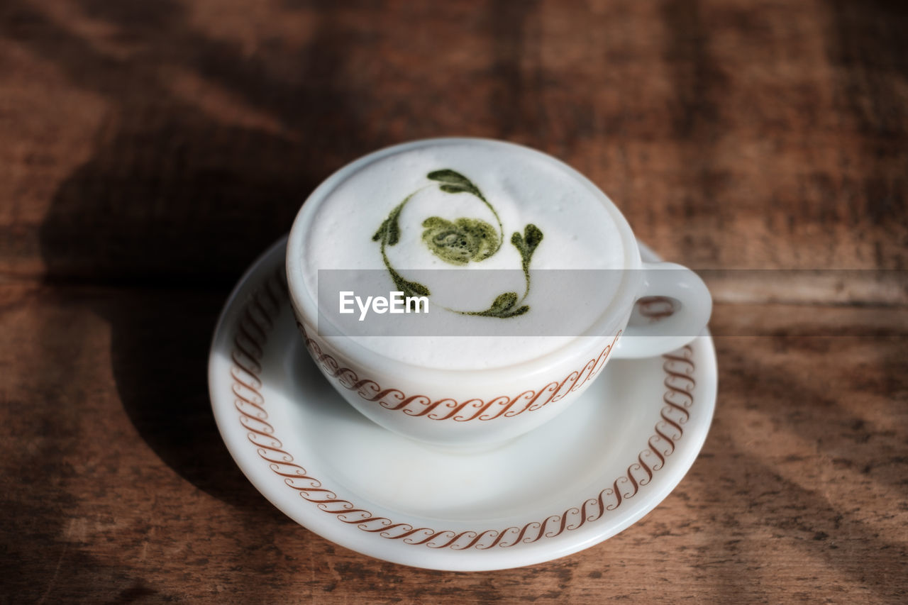 Close-up of frothy drink on table