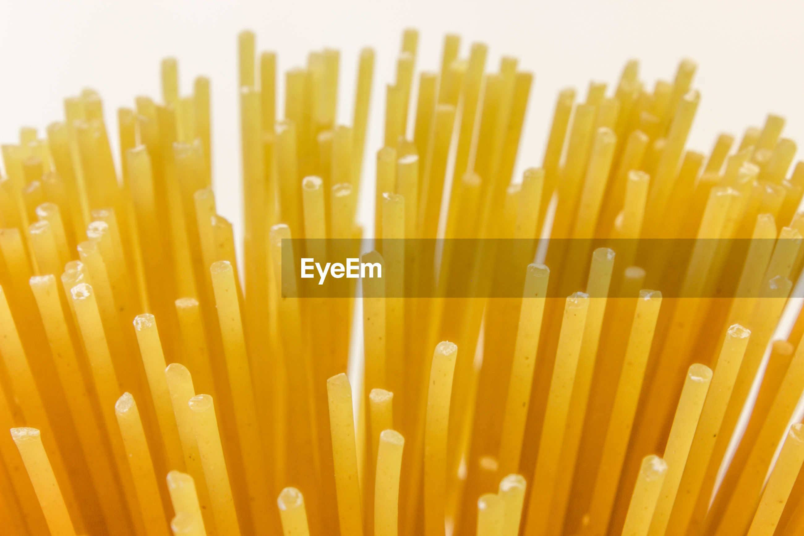 Extreme close up of uncooked spaghetti noodles