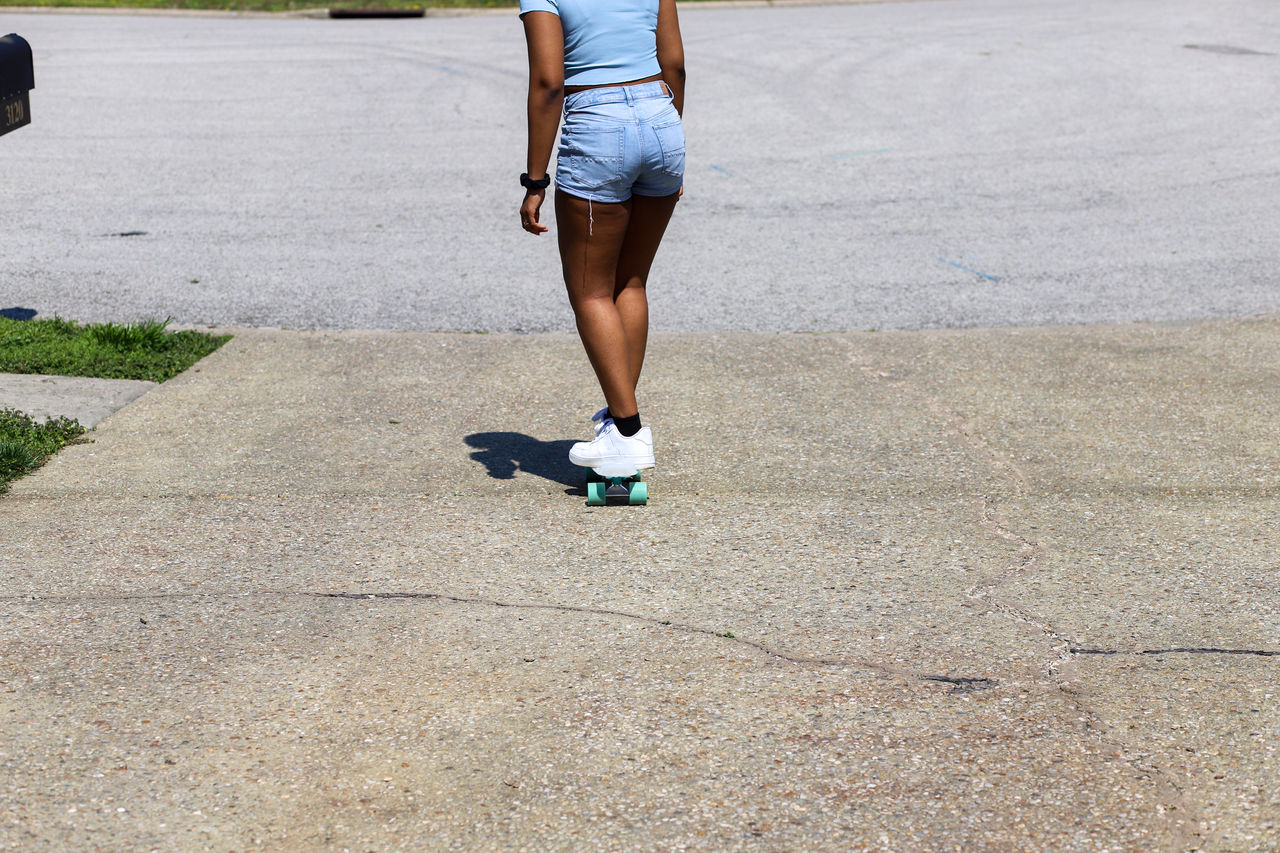 An african-american teenaged girl with a skateboard