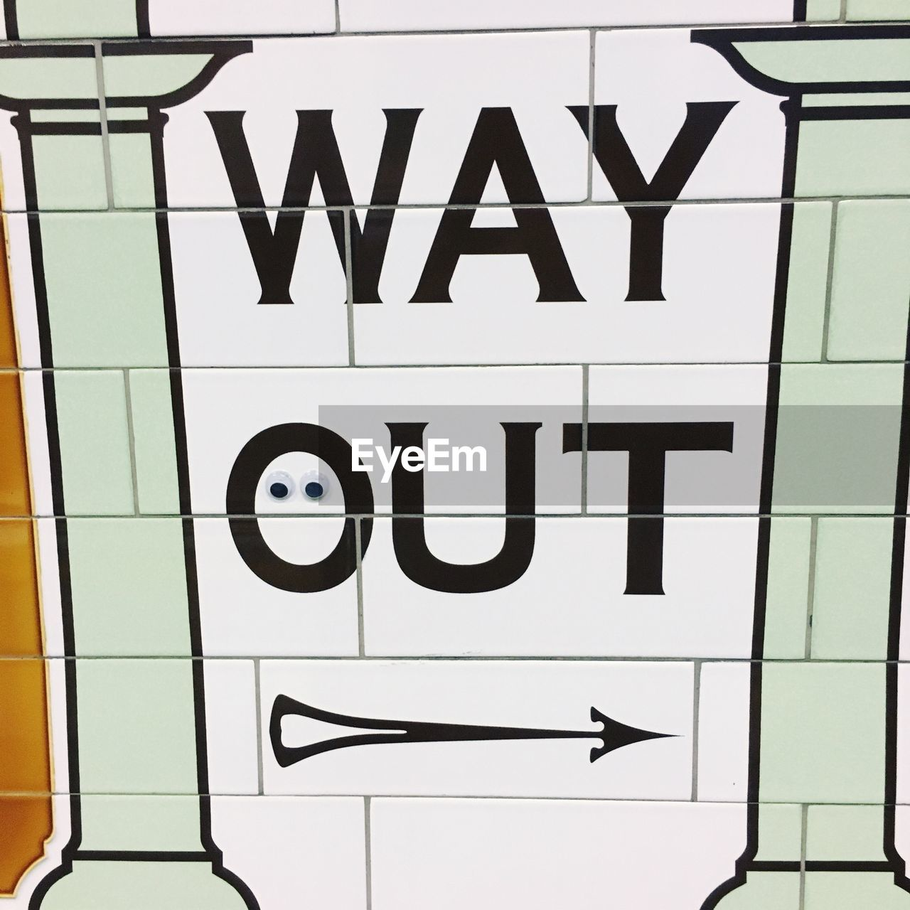 Way Out Text With Arrow Symbol On Wall