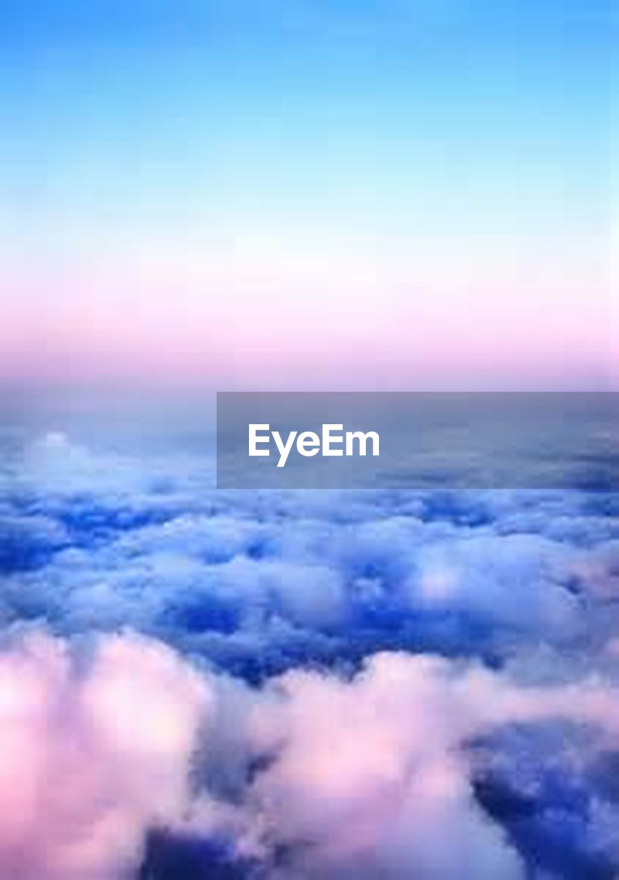 cloud - sky, sky, backgrounds, abstract, nature, cloudscape, scenics, beauty in nature, blue, tranquil scene, no people, tranquility, sunset, ethereal, purple, pink color, sky only, aspirations, outdoors, space, multi colored, futuristic, day, close-up