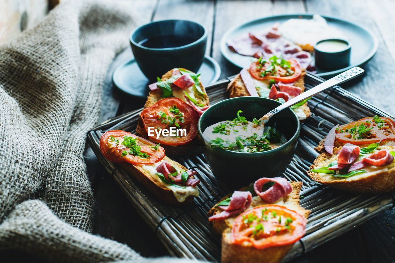 food and drink, food, freshness, ready-to-eat, vegetable, healthy eating, table, meat, plate, indoors, no people, meal, wellbeing, high angle view, serving size, bowl, close-up, eating utensil, still life, selective focus, tray, table knife, snack