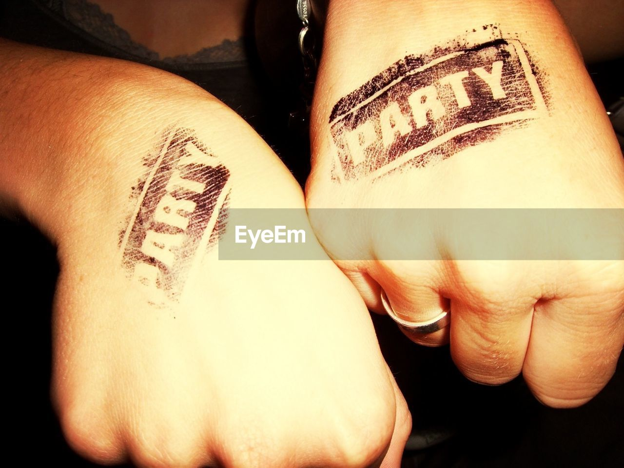 Cropped Image Of Women With Party Stamps On Hands