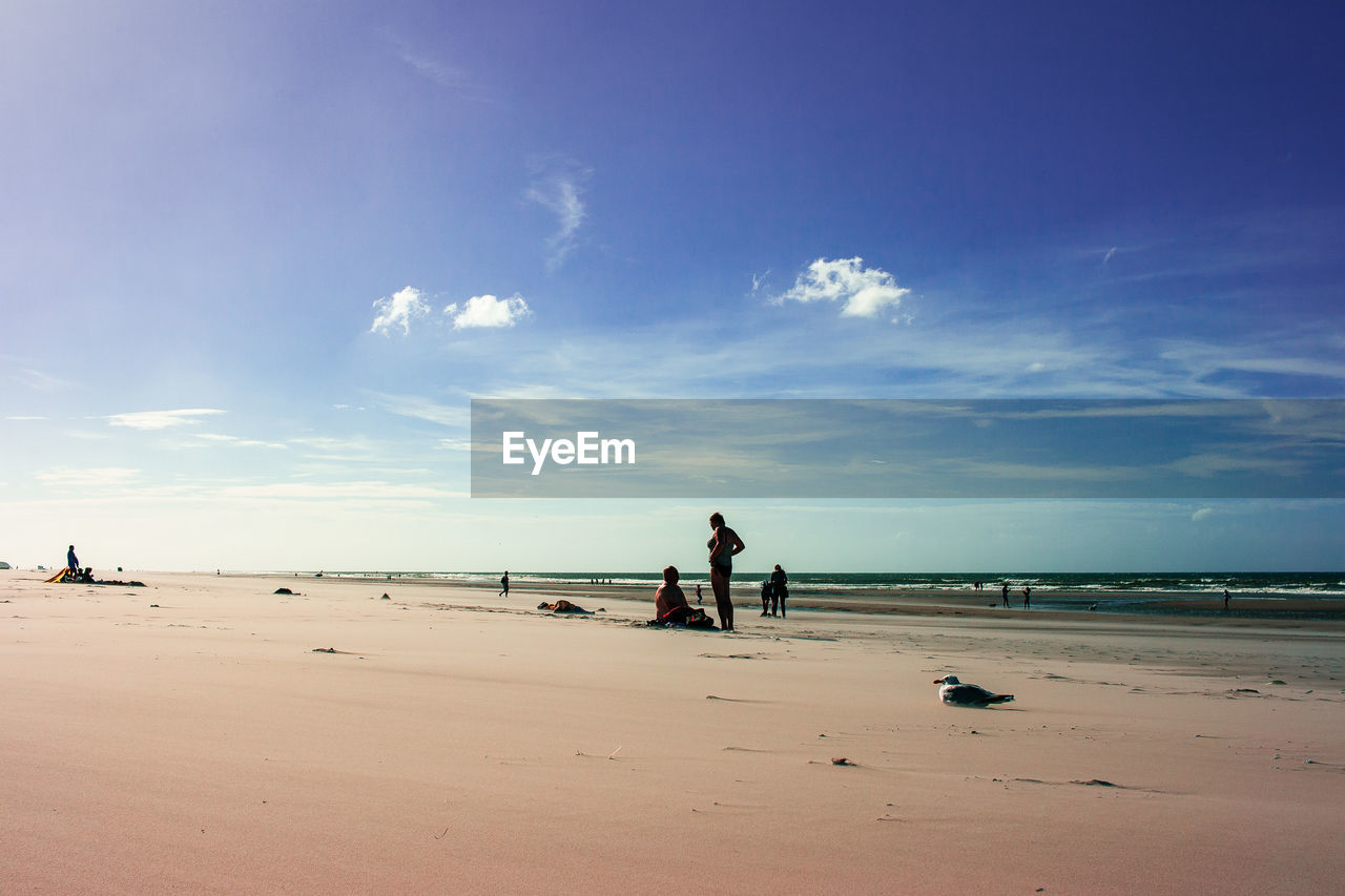sea, beach, sky, land, water, cloud - sky, beauty in nature, sand, real people, scenics - nature, horizon, horizon over water, nature, leisure activity, tranquility, lifestyles, incidental people, men, tranquil scene, outdoors