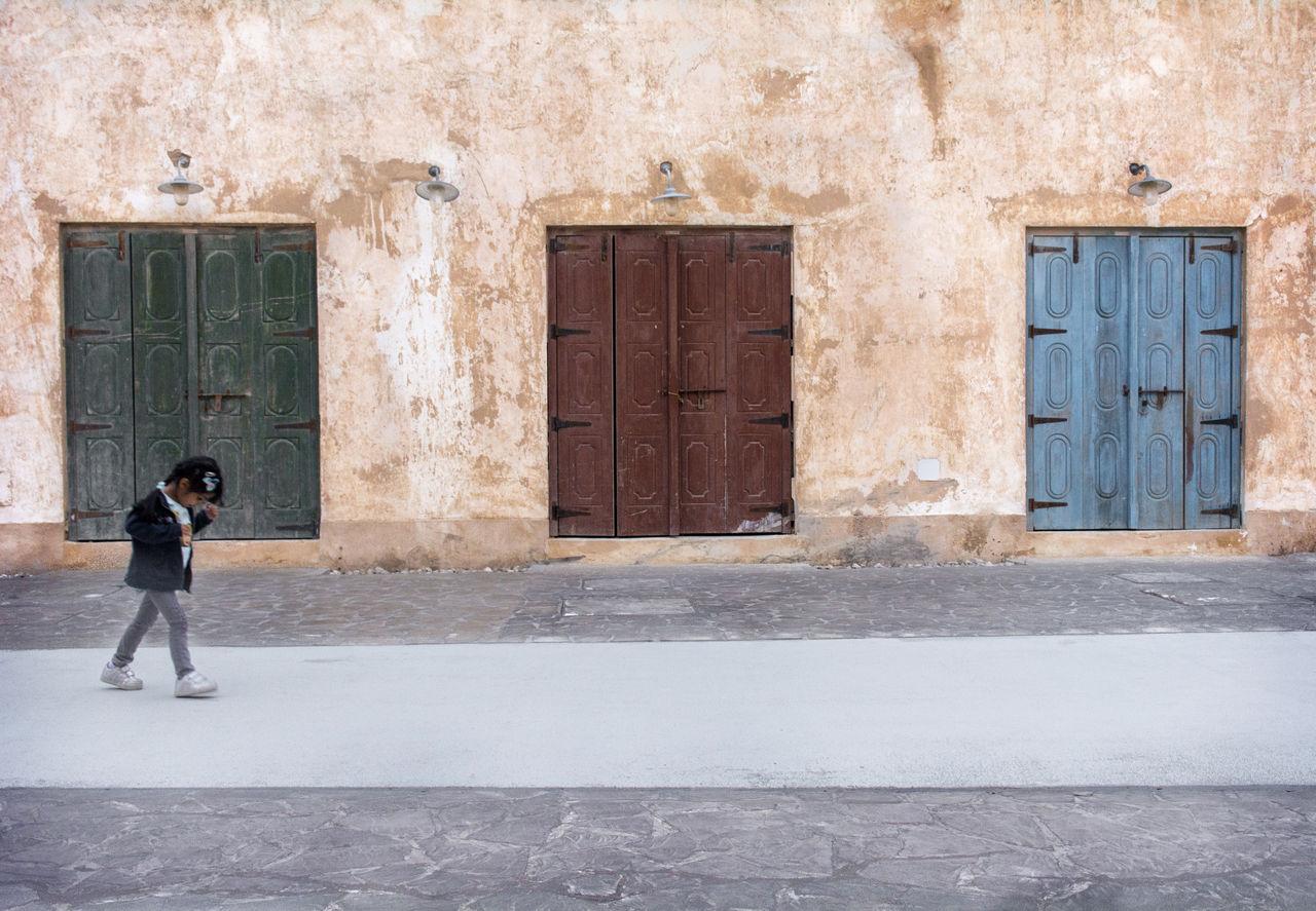 WOMAN STANDING AGAINST DOOR
