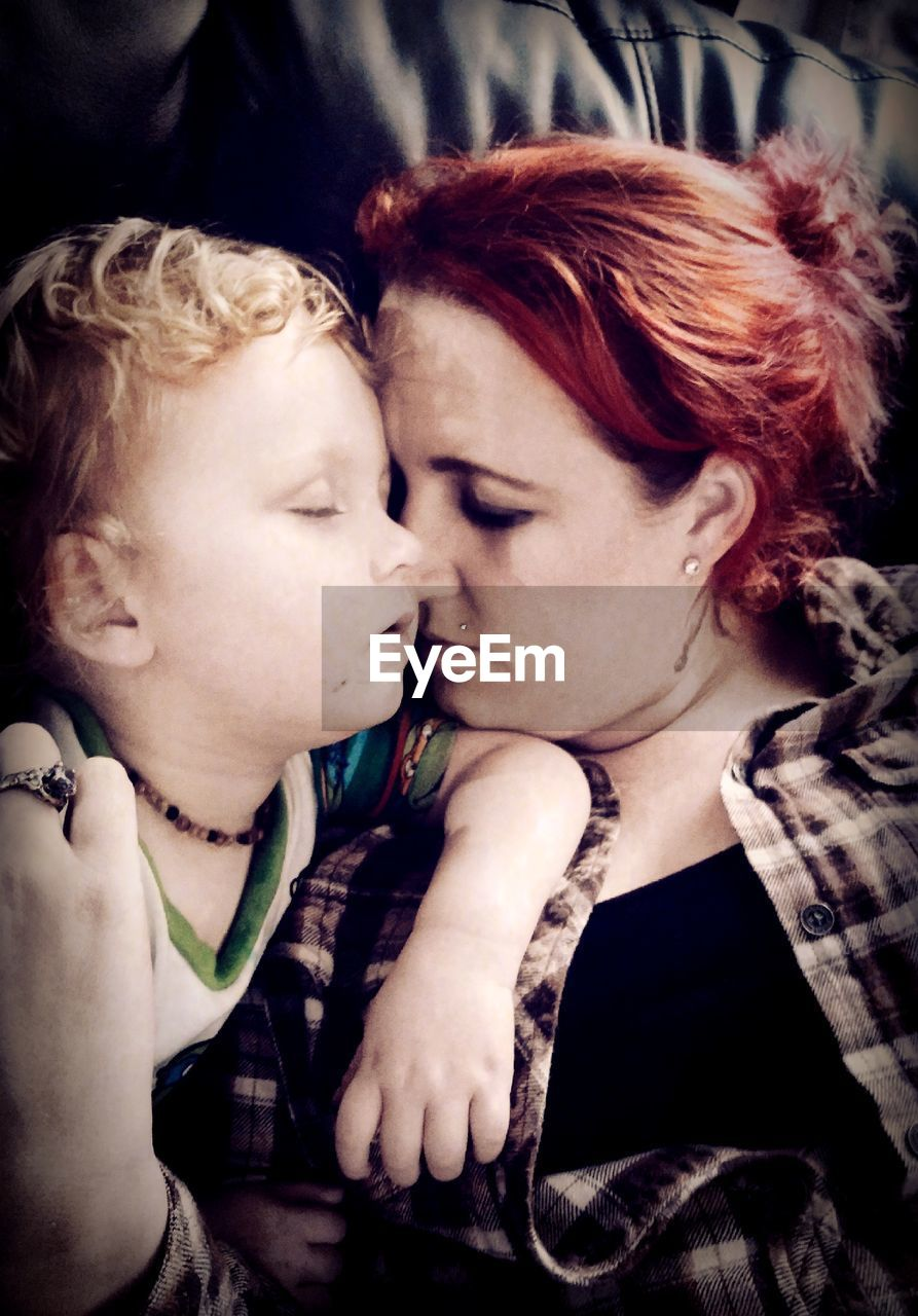 love, redhead, togetherness, real people, family with one child, kissing, childhood, headshot, bonding, indoors, leisure activity, lifestyles, boys, close-up, young women, young adult, day, adult, people