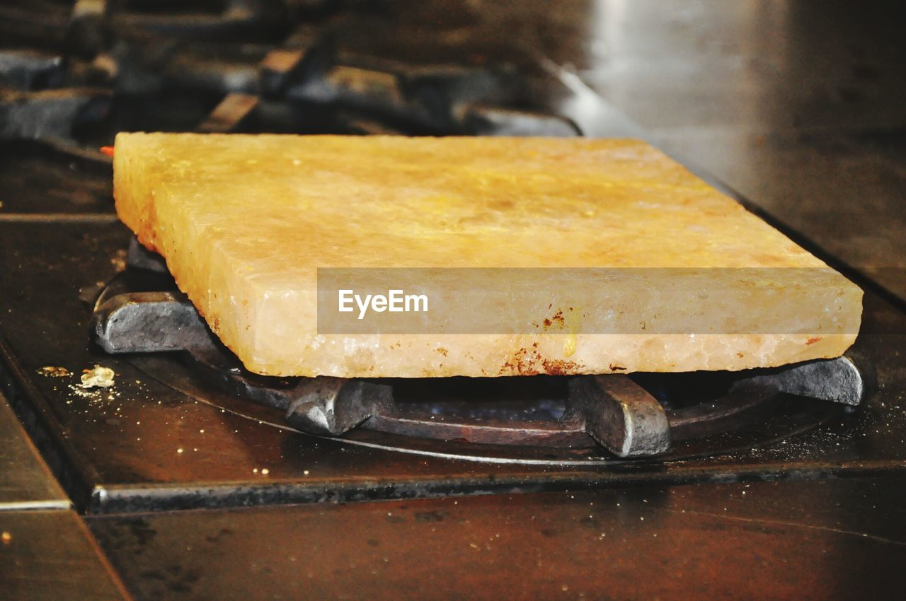 food, food and drink, still life, freshness, indoors, no people, close-up, dairy product, cheese, wellbeing, preparation, focus on foreground, table, high angle view, indulgence, metal, bread, ready-to-eat, selective focus, wood - material, tray, temptation