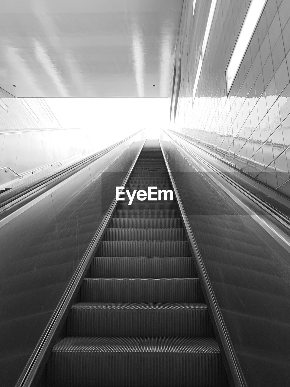 LOW ANGLE VIEW OF ESCALATOR IN UNDERGROUND