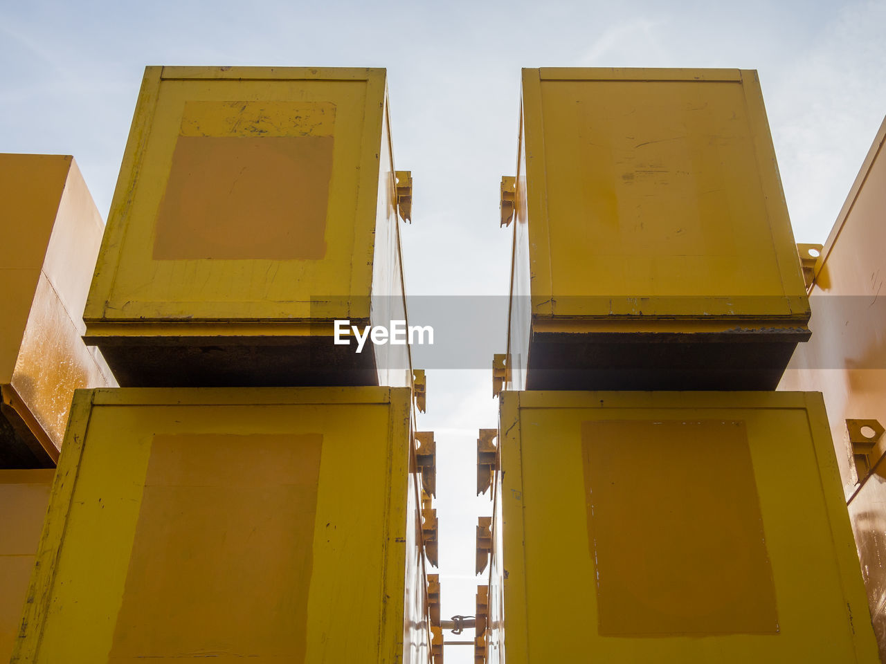 Low angle view of yellow construction containers