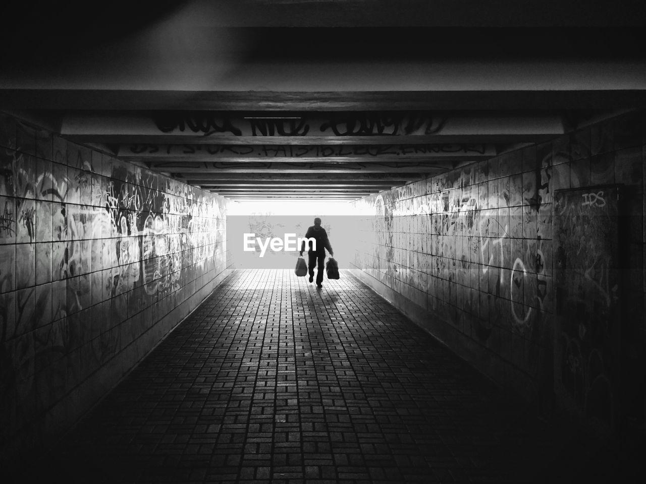 Man Walking In Tunnel