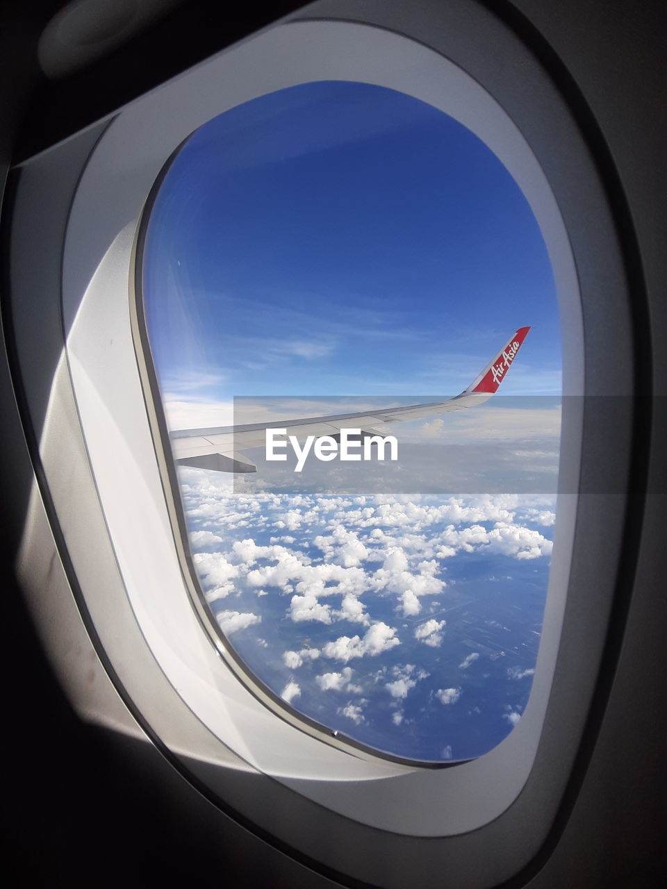 airplane, air vehicle, transportation, mode of transportation, cloud - sky, window, flying, vehicle interior, sky, travel, glass - material, aircraft wing, mid-air, transparent, beauty in nature, journey, nature, no people, public transportation, scenics - nature, outdoors