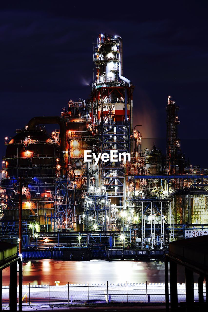 night, illuminated, built structure, factory, no people, smoke stack, industry, architecture, building exterior, refinery, sky, outdoors