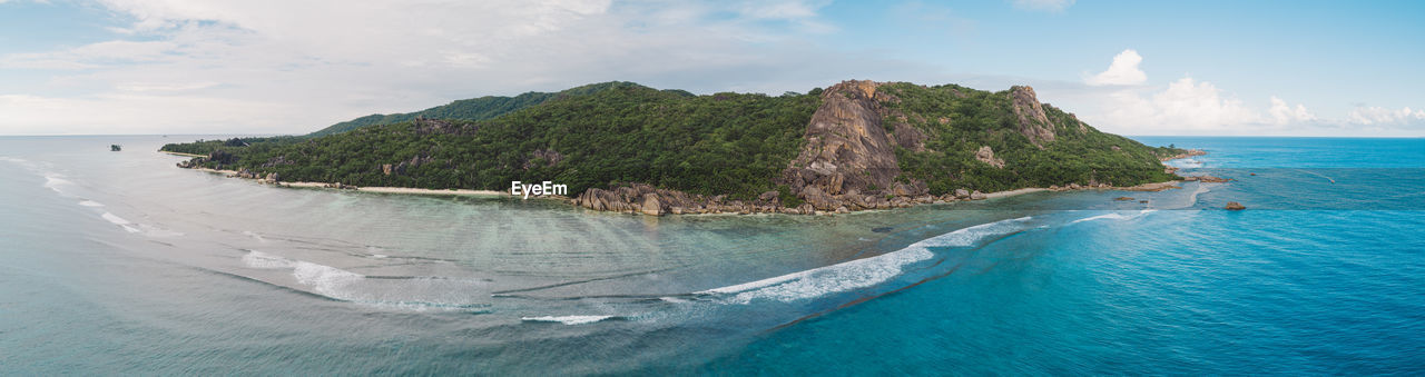 water, sea, sky, scenics - nature, beauty in nature, tranquil scene, land, cloud - sky, beach, tranquility, nature, mountain, no people, day, idyllic, nautical vessel, turquoise colored, non-urban scene, horizon over water, outdoors, bay