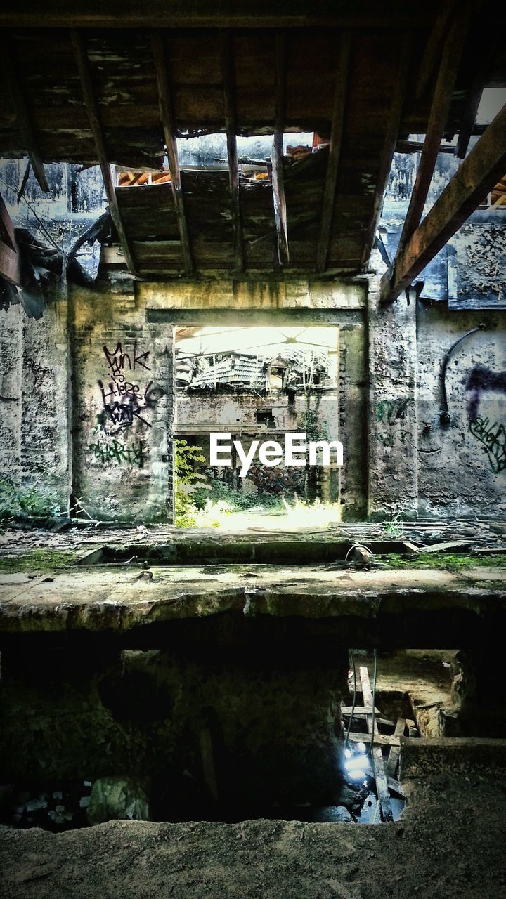 graffiti, architecture, built structure, day, bridge - man made structure, street art, no people, water, indoors, building exterior, under