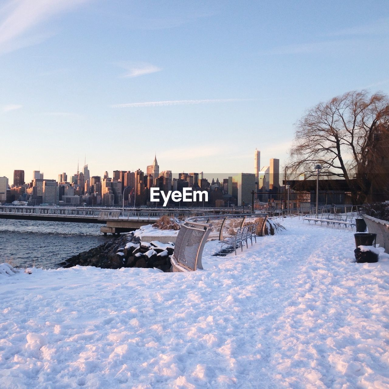River Bank In Snow And Waterfront In Background