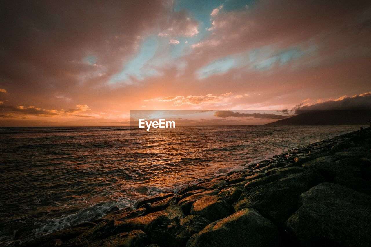 sky, sunset, beauty in nature, cloud - sky, water, sea, scenics - nature, tranquility, tranquil scene, land, beach, horizon, horizon over water, idyllic, nature, no people, rock, non-urban scene, solid, outdoors