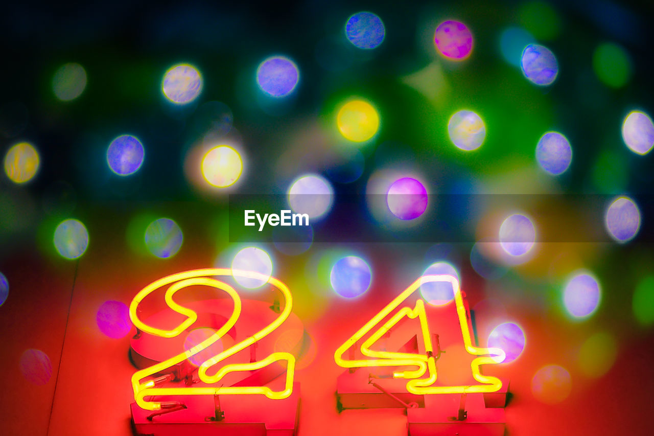 Close-Up Of Illuminated Numbers At Night