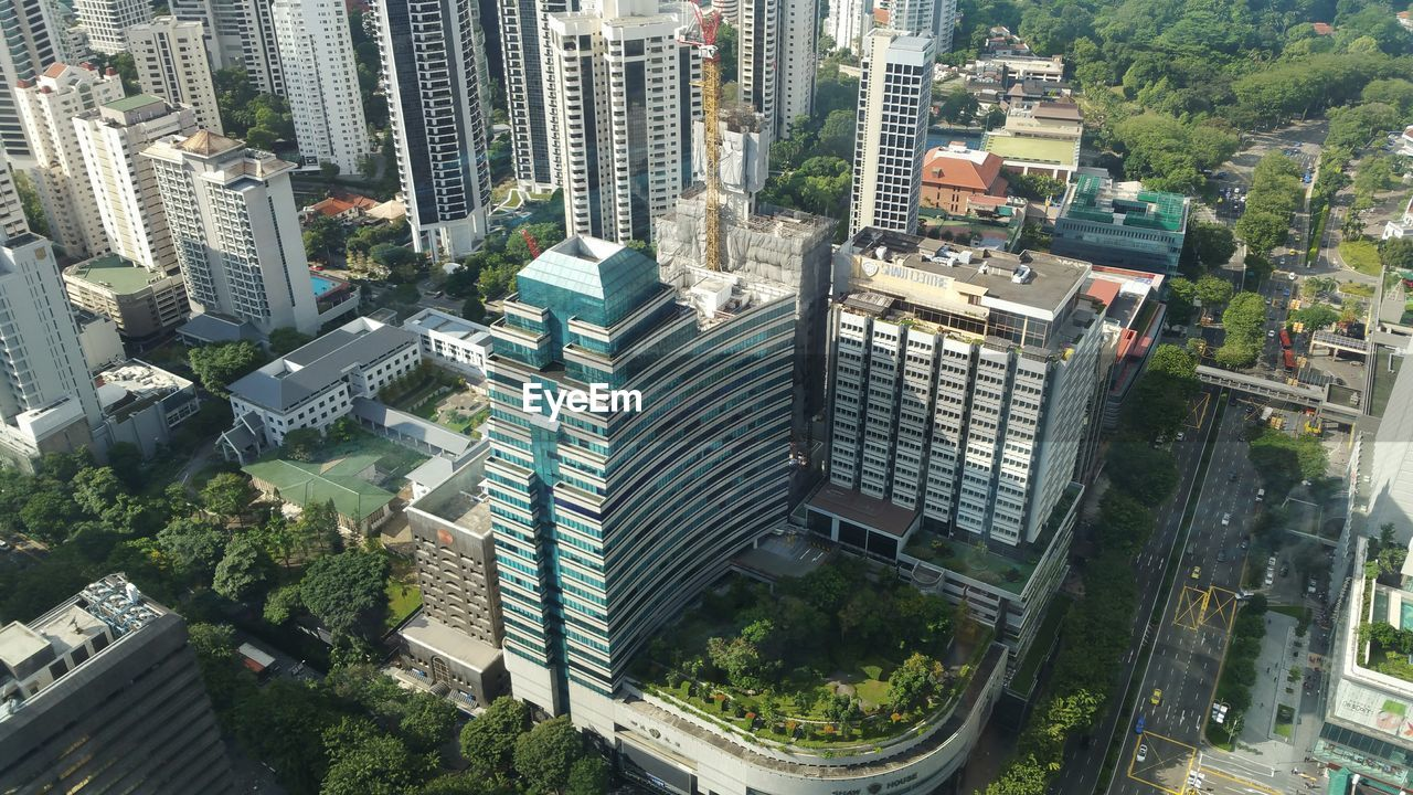 city, architecture, building exterior, high angle view, skyscraper, modern, cityscape, aerial view, built structure, outdoors, road, day, no people, growth, tree