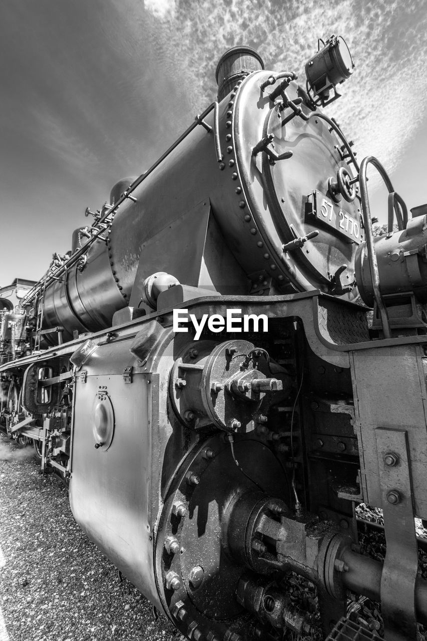 mode of transportation, transportation, engine, day, metal, technology, land vehicle, outdoors, no people, nature, sky, connection, machinery, close-up, pipe - tube, industry, rail transportation, stationary, train
