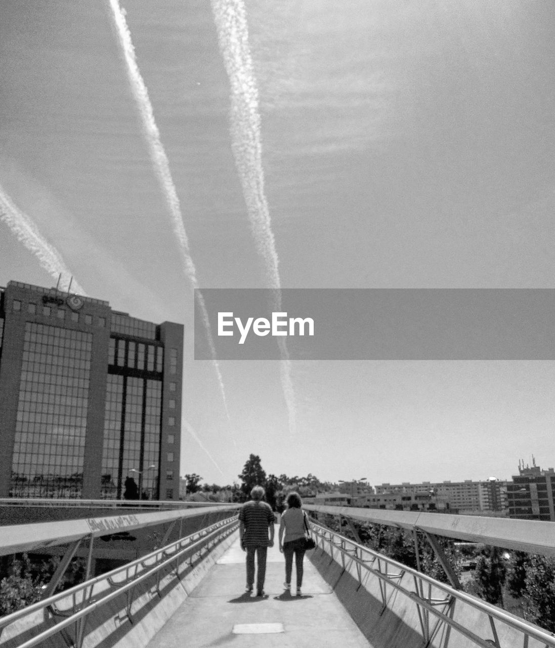 transportation, vapor trail, built structure, real people, day, bridge - man made structure, architecture, outdoors, clear sky, nature, sky