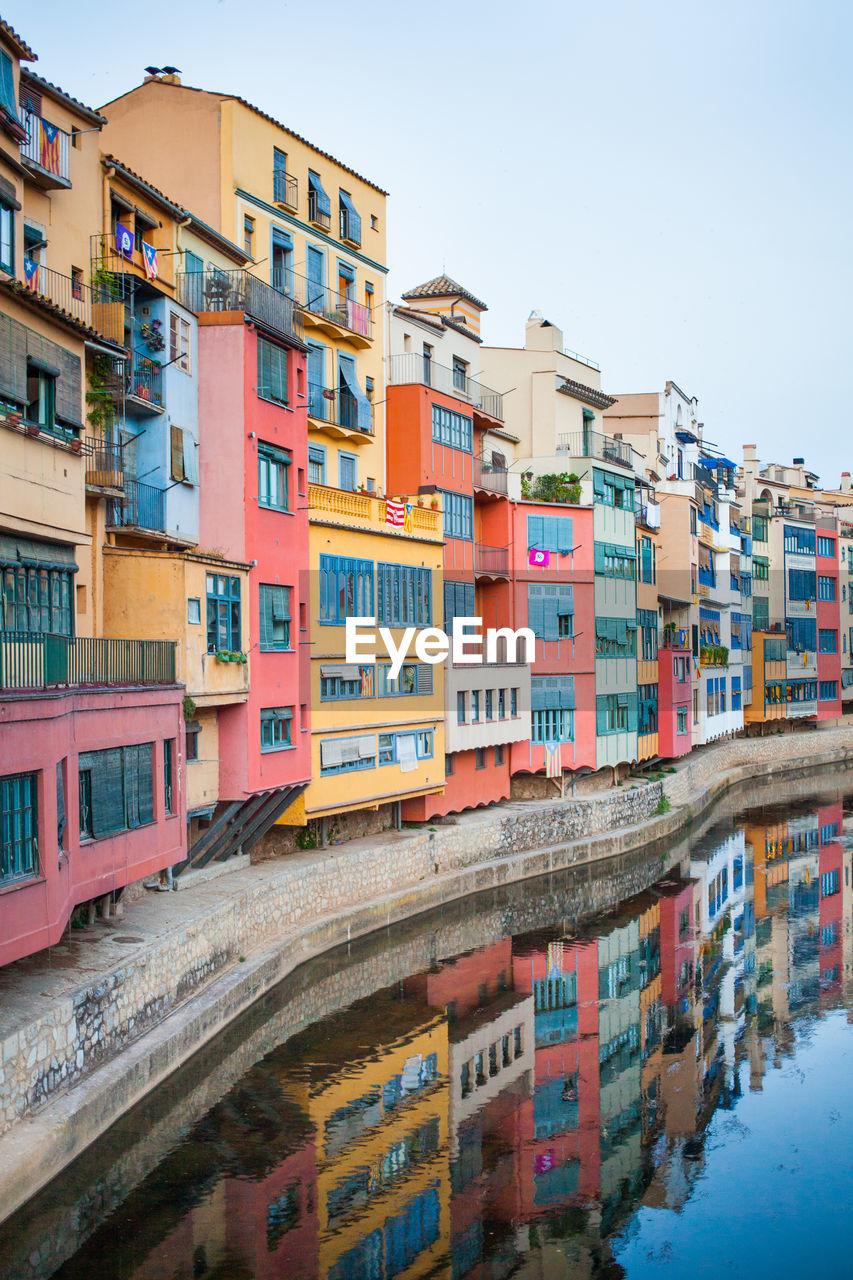 RESIDENTIAL BUILDINGS AGAINST CLEAR SKY IN CITY