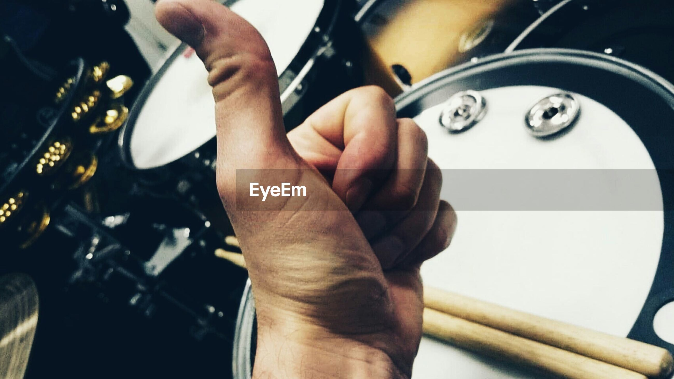 Close-up of drummer showing thumbs up sign