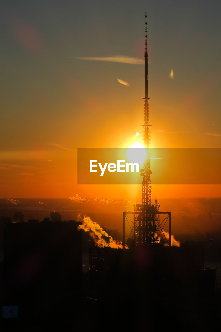 sunset, sky, built structure, architecture, orange color, tower, sun, silhouette, nature, no people, building exterior, technology, tall - high, cloud - sky, outdoors, beauty in nature, industry, metal, city, global communications