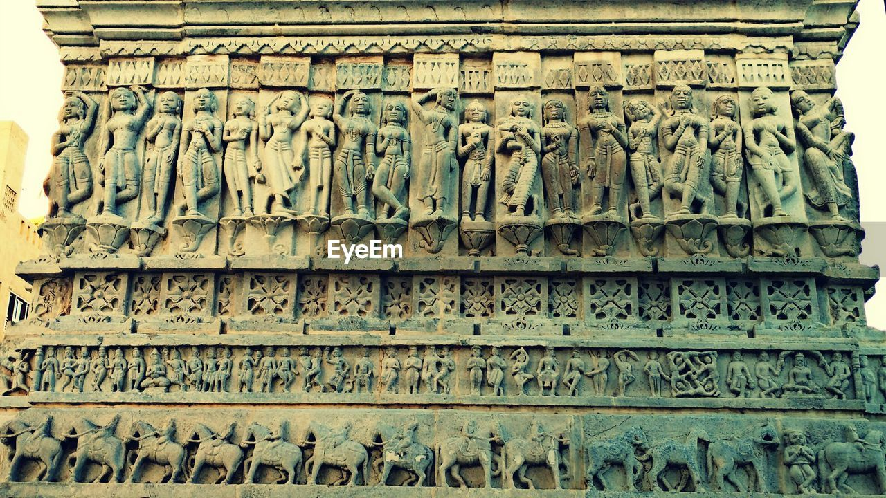 text, art and craft, communication, architecture, carving - craft product, low angle view, day, history, outdoors, sculpture, no people, built structure, bas relief, building exterior, close-up