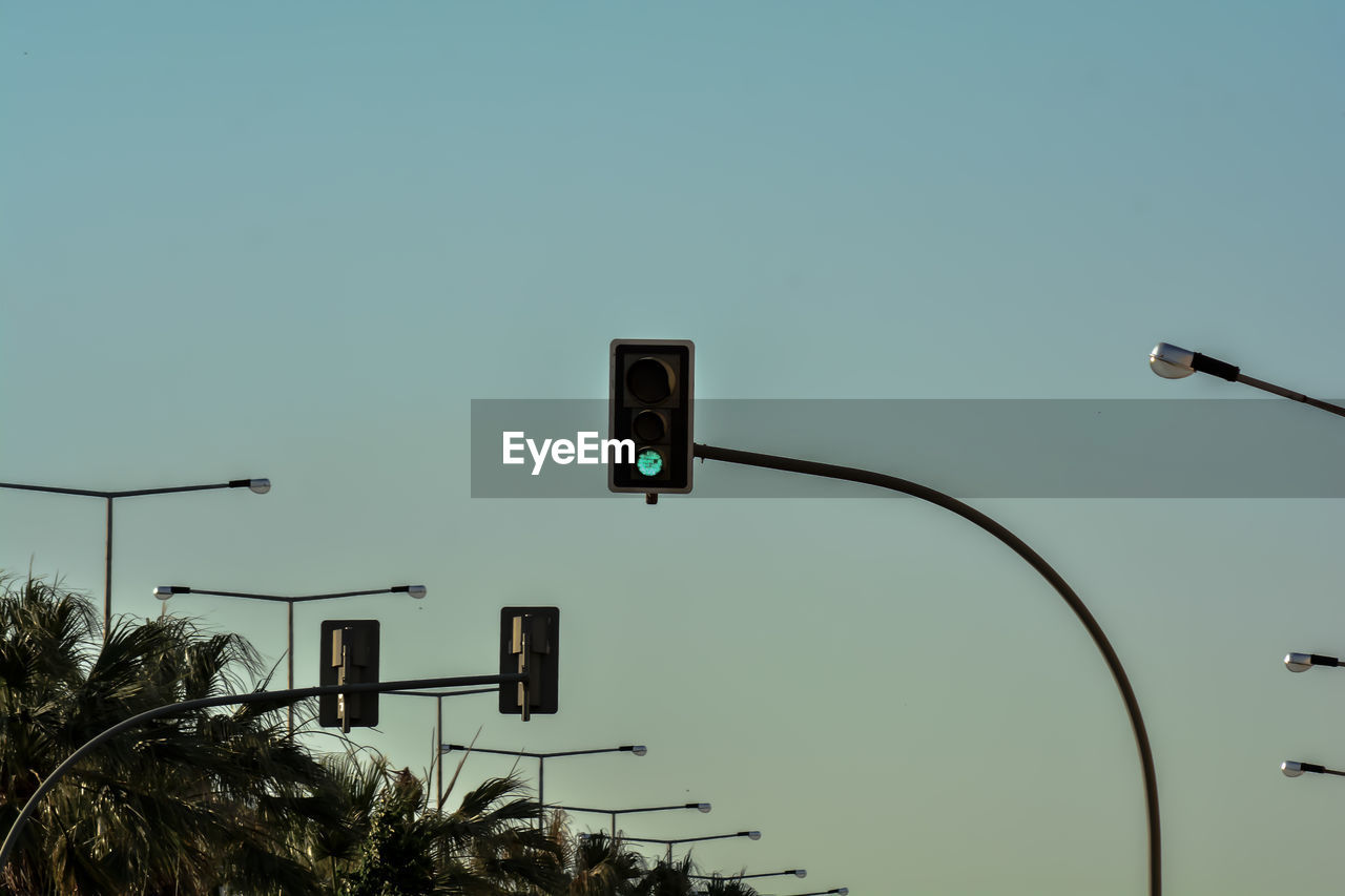 sky, stoplight, copy space, street light, low angle view, no people, nature, road signal, light, green light, sign, lighting equipment, communication, clear sky, green color, street, guidance, blue, outdoors, technology