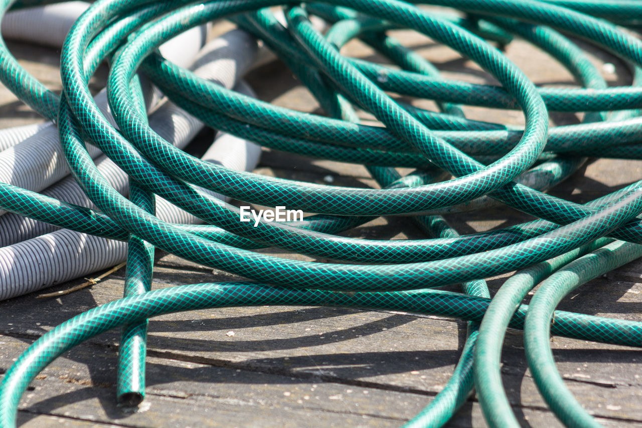 green color, strength, connection, rope, cable, close-up, complexity, full frame, no people, outdoors, day, flexibility